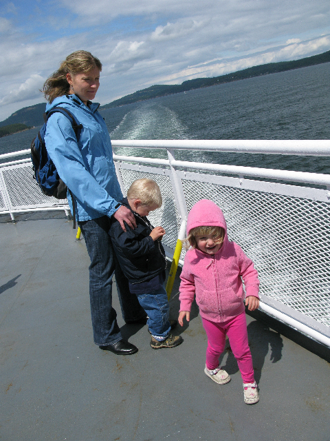 Toddlers and parent on ferry boat.