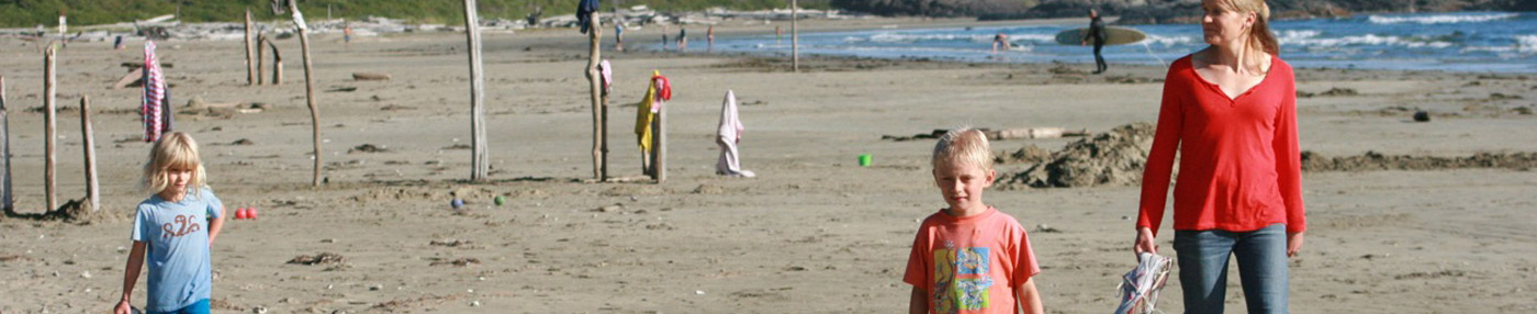 Jenny Manzer and children at the beach, on the sand